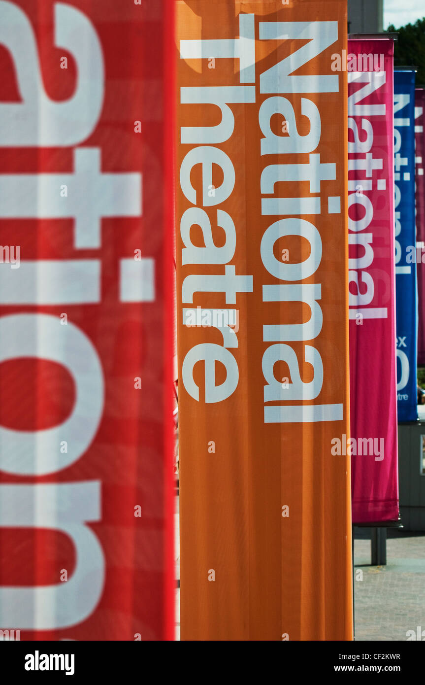 Multi-coloured banners hanging outside the National Theatre on the South Bank. - Stock Image