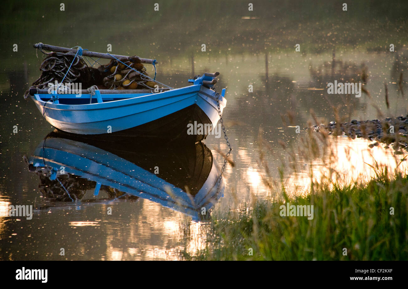 A small fishing boat at Canny fishery by Norham Boathouse. - Stock Image