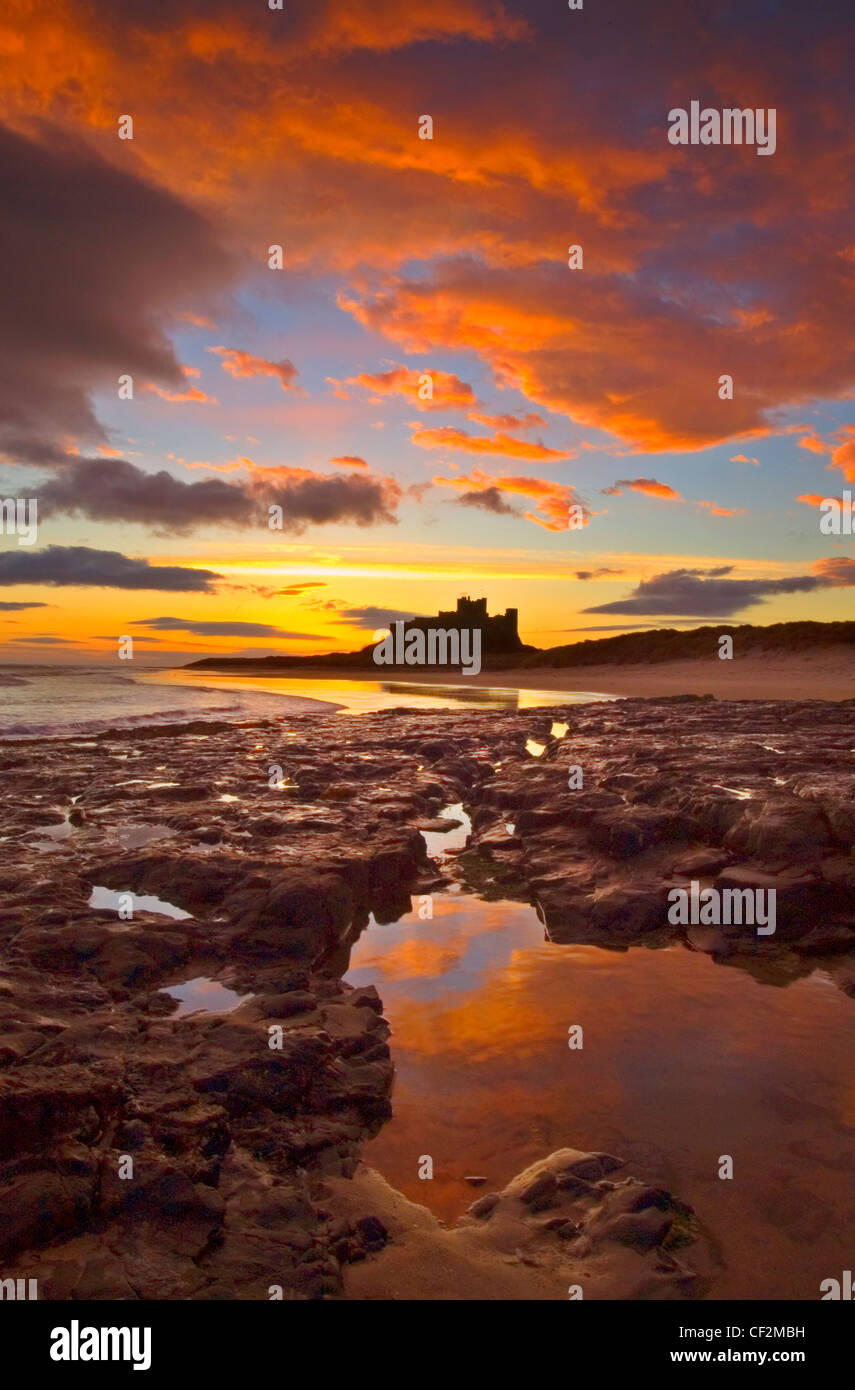 Bamburgh Castle on the coastline of Northumberland. Once the residence of the Kings of Northumbria, this imposing - Stock Image