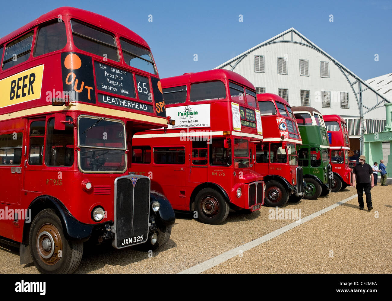 A line of historic double decker buses on display at the Chatham Historic Dockyard. - Stock Image