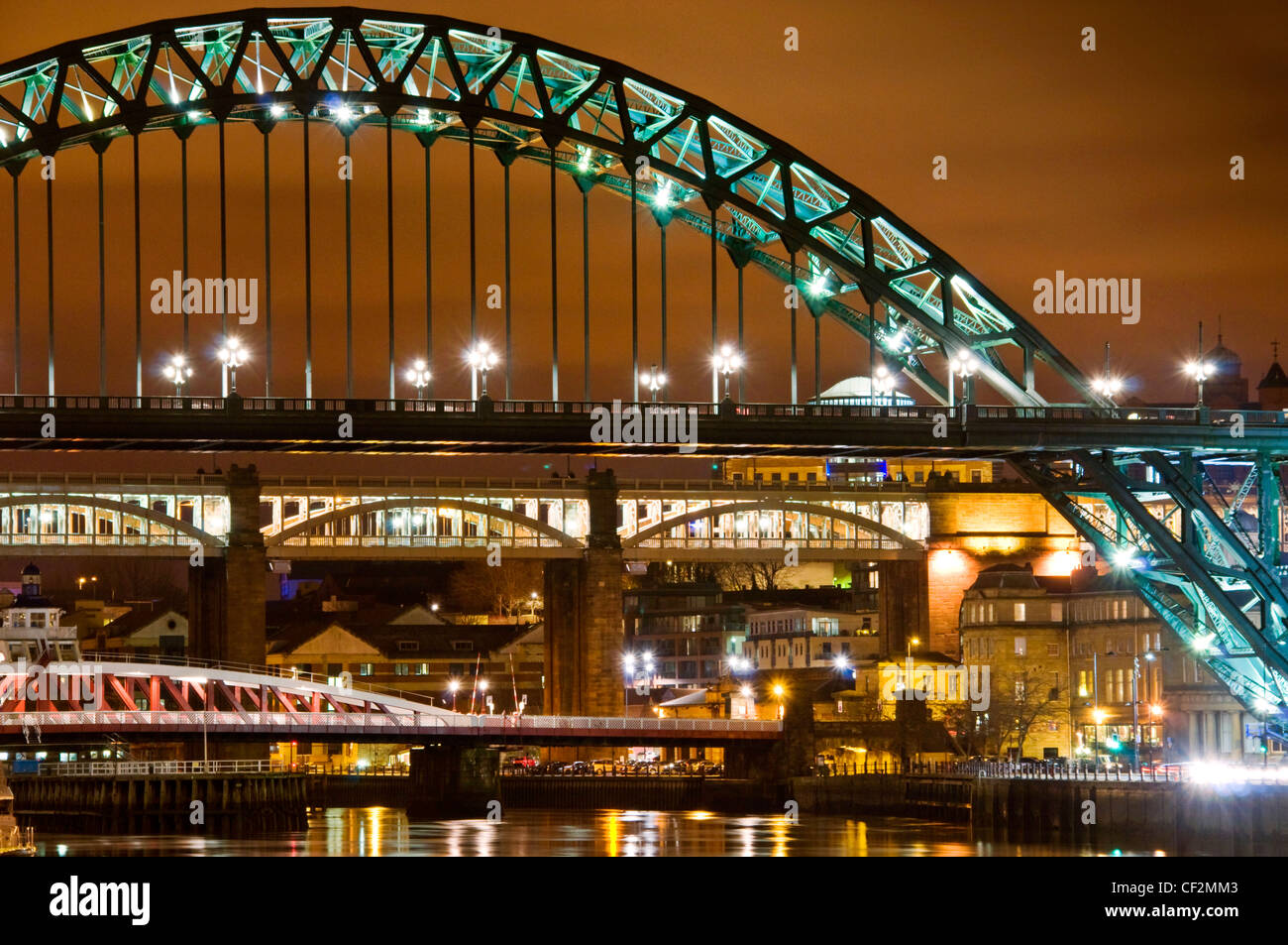 Evening view of the famous Tyne Bridges spanning the River Tyne to link Newcastle upon Tyne on the northern side - Stock Image