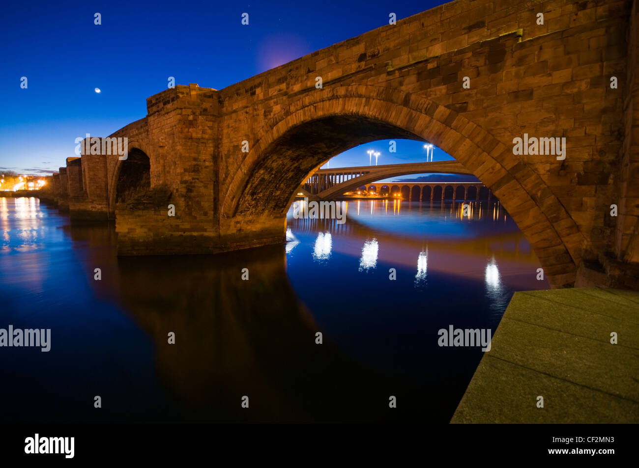 A night view of the bridges of Berwick upon Tweed, with the Old Bridge built between 1610 and 1624, then the Royal - Stock Image