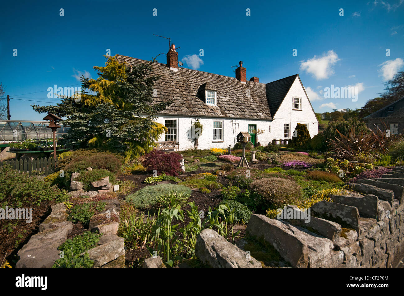 A country cottage and garden in the picturesque village of Etal in the north east of England, close to the border Stock Photo