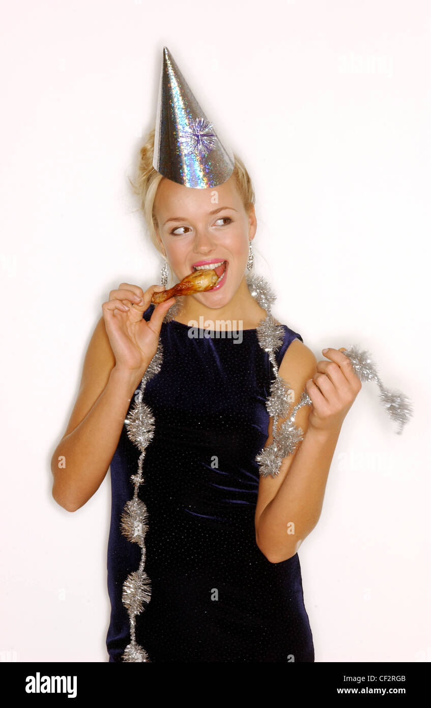 Model Blonde Hair Off Face Wearing Silver Party Hat Silver Earrings