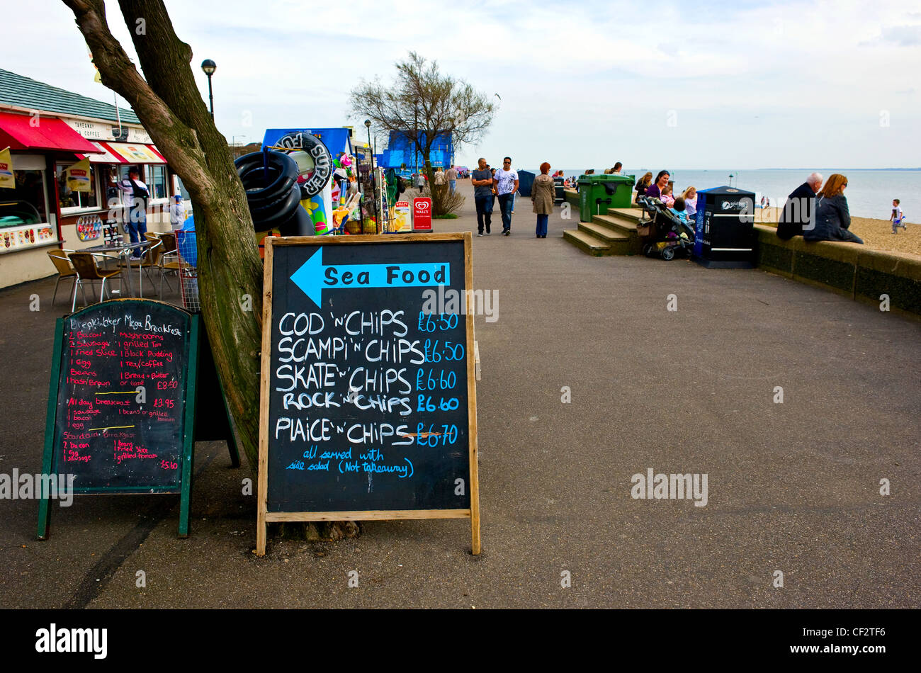 Signs advertising fast food on the seafront at Southend-on-Sea. - Stock Image