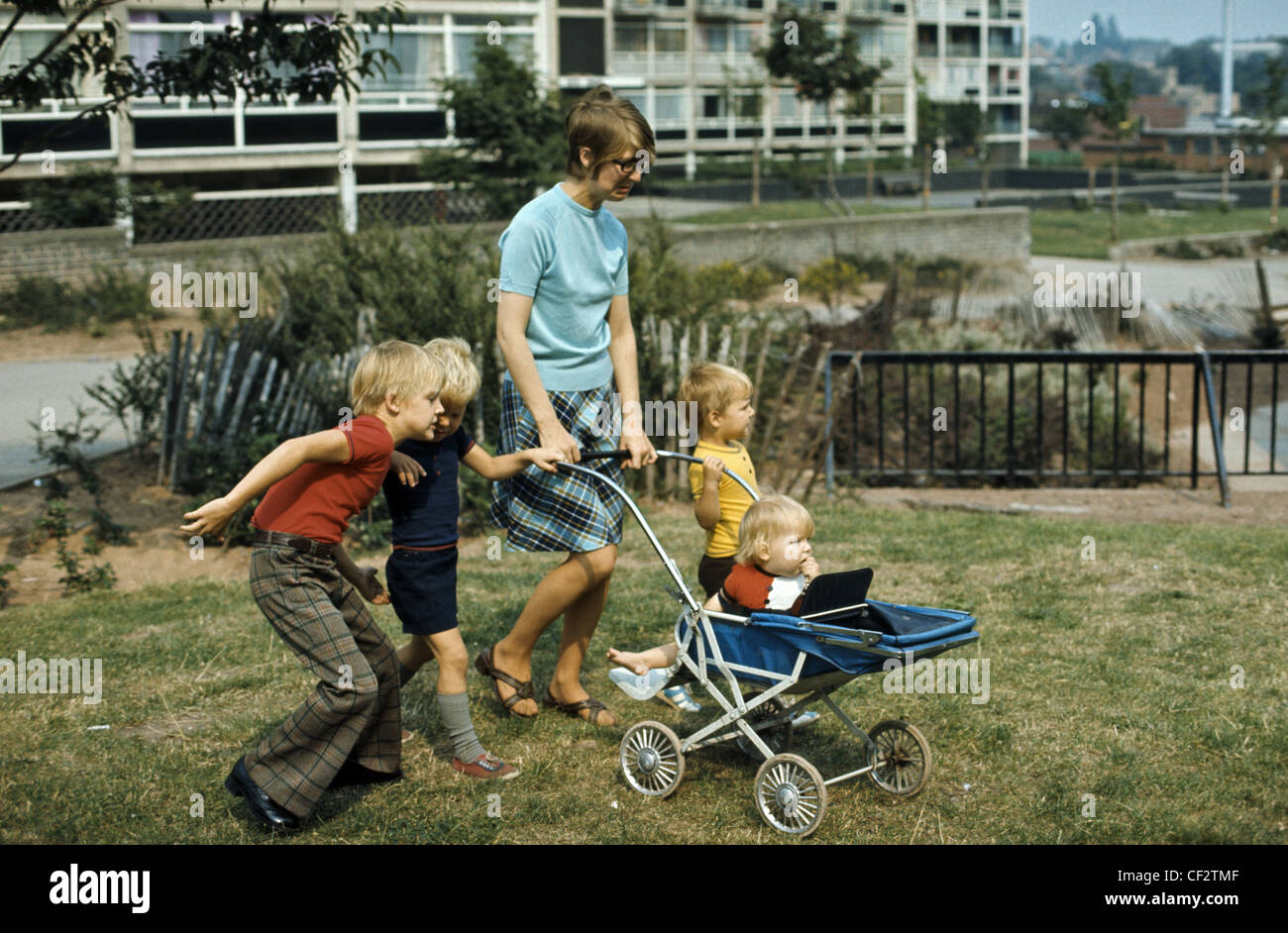 1960's image of mother out and about with children - Stock Image