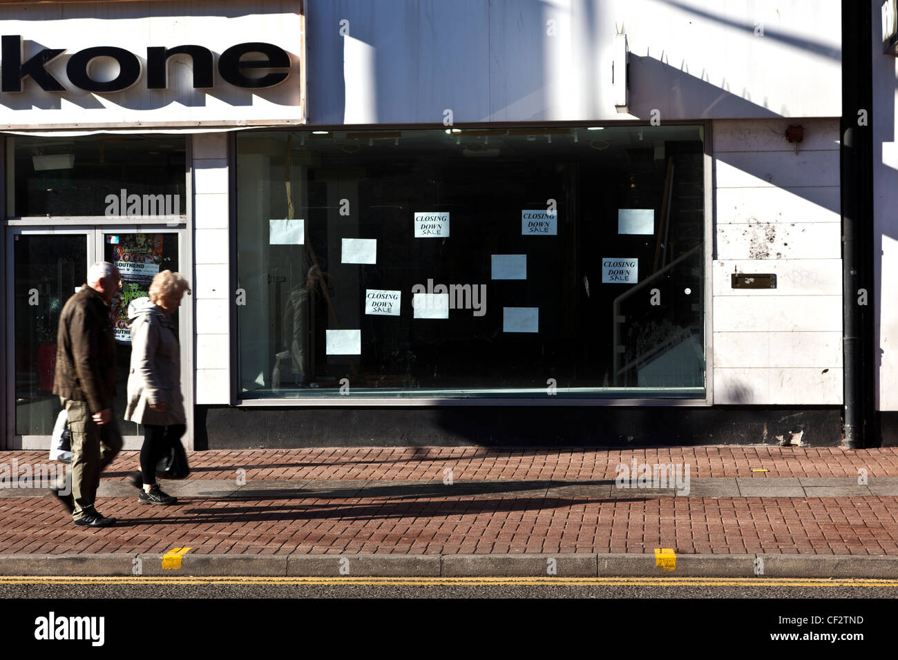 Unidentified People Walking Past Closed Retail Outlet in Southend Stock Photo