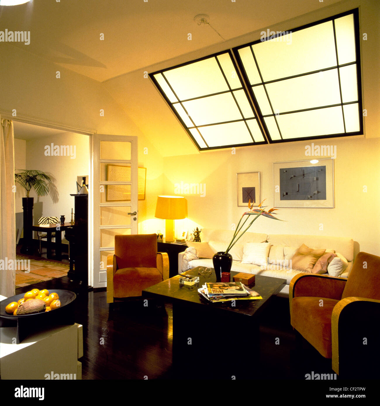 Living room cream walls and ceiling large art deco style skylight ...