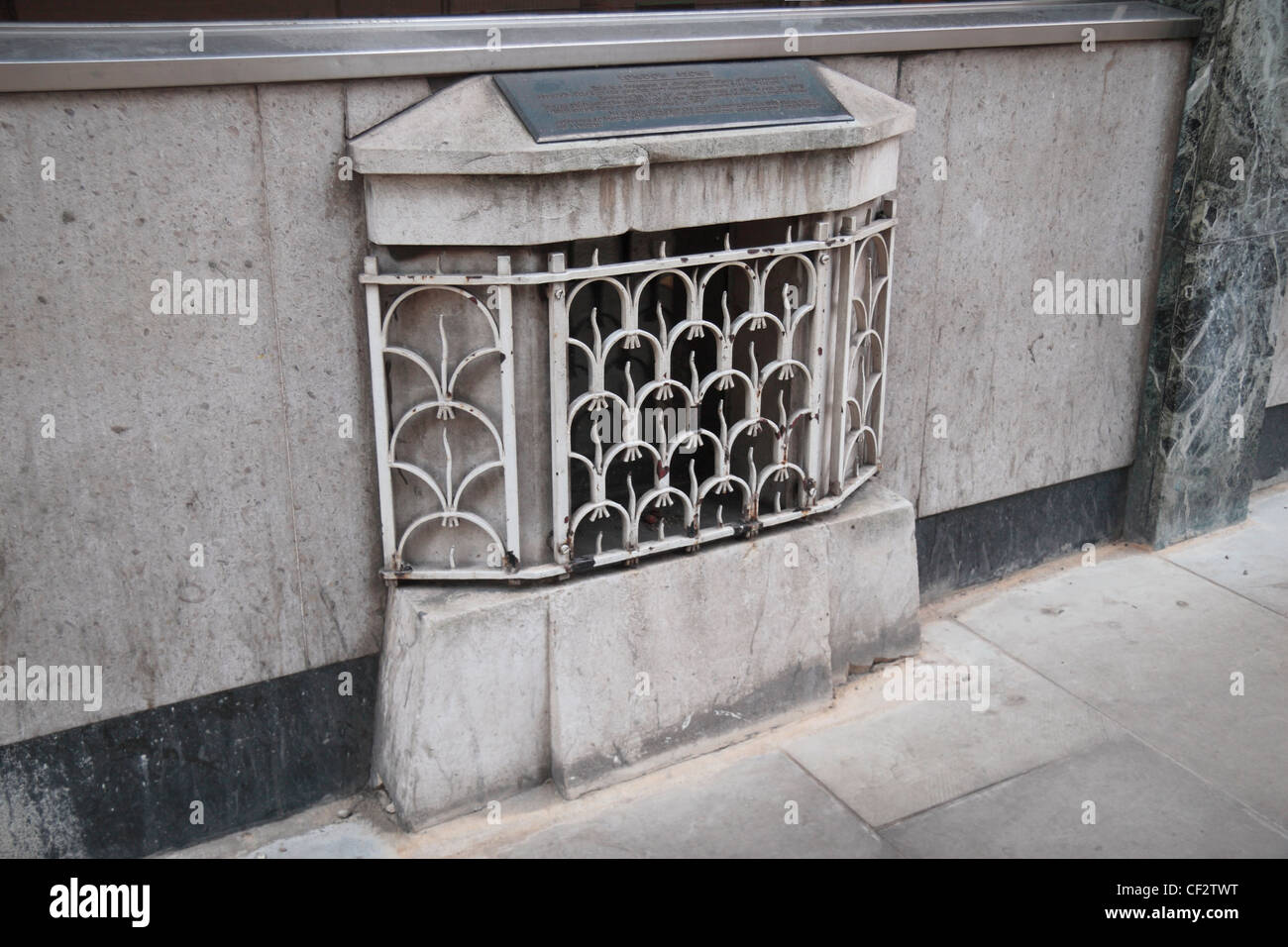 The London Stone, a historic stone hidden behind this iron grille on Cannon Street, London, UK. - Stock Image