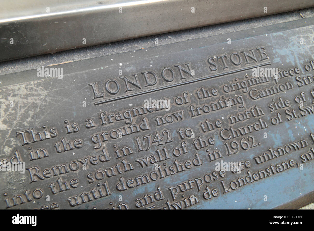 Information plaque above the London Stone, a historic stone hidden behind this iron grille on Cannon Street, London, - Stock Image