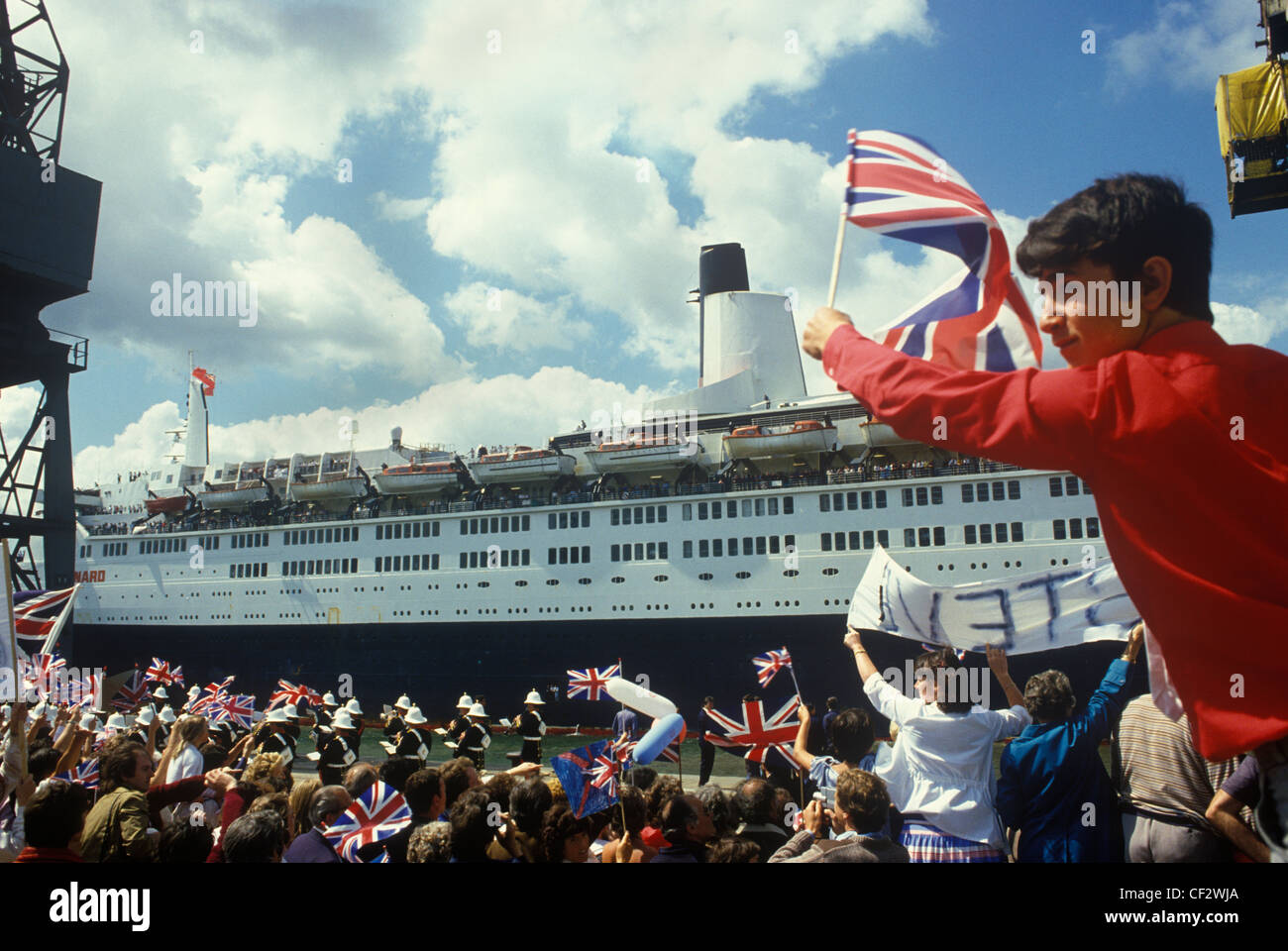 Queen Elizabeth 2 QE2 returns from the Falklands  Southampton Dock Hampshire Uk 1982. - Stock Image