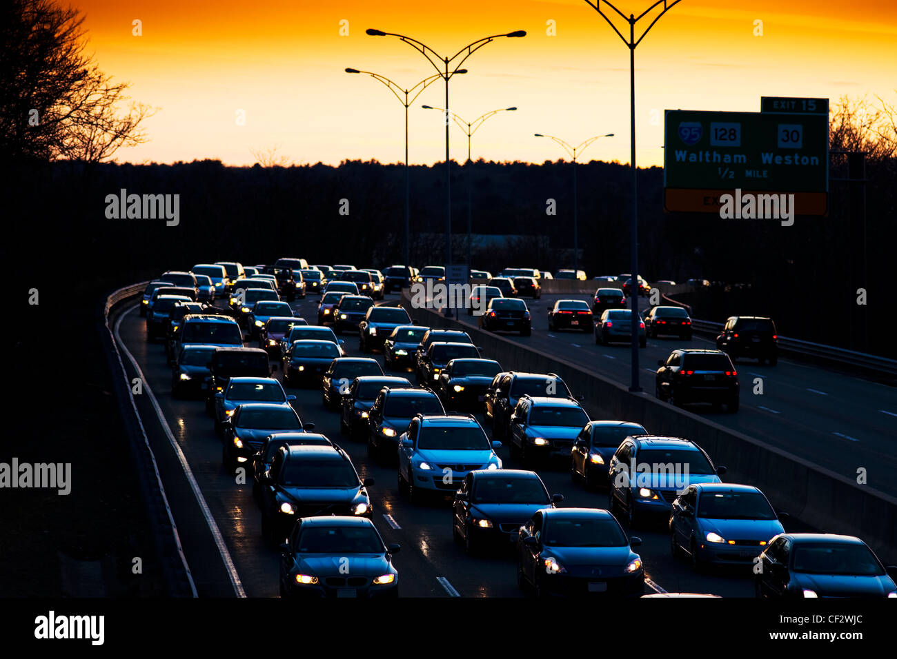 Traffic jam at sunset during the evening commute - Stock Image