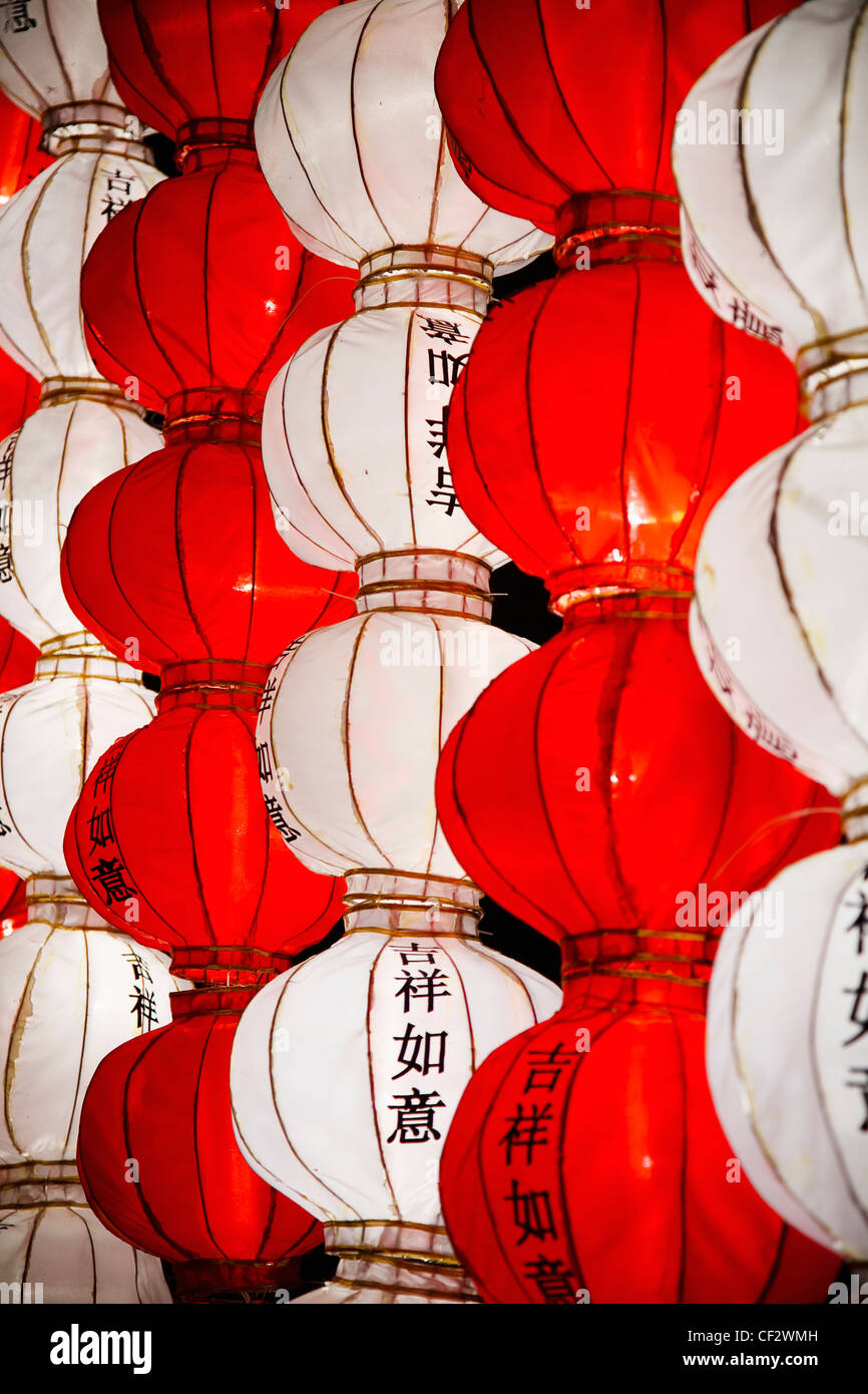 Red And White Chinese Lanterns With 'good Luck' In The Chinese Language; Beijing China - Stock Image