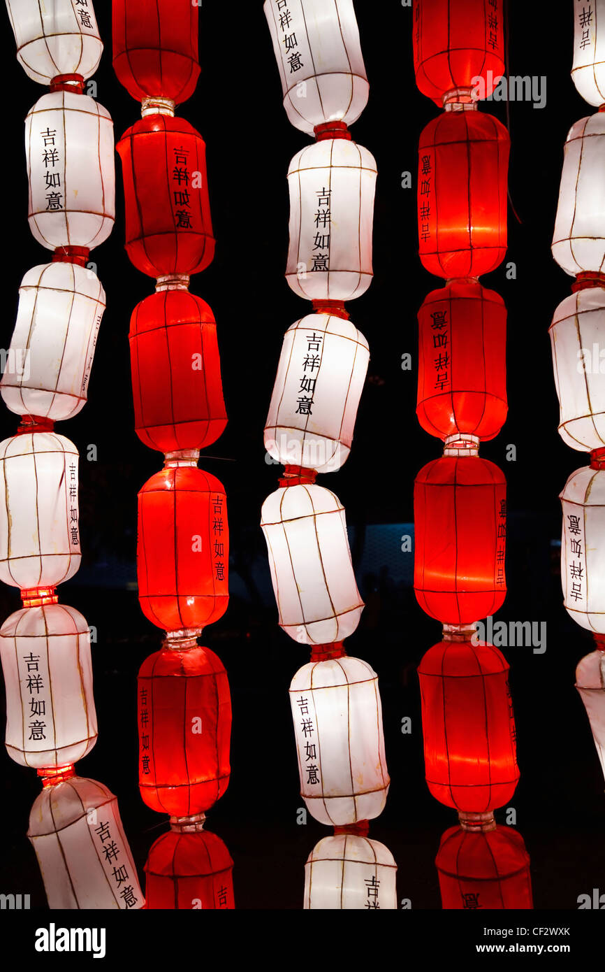 Red And White Chinese Lanterns Saying 'good Luck' In The Chinese Language; Chiang Mai Thailand - Stock Image