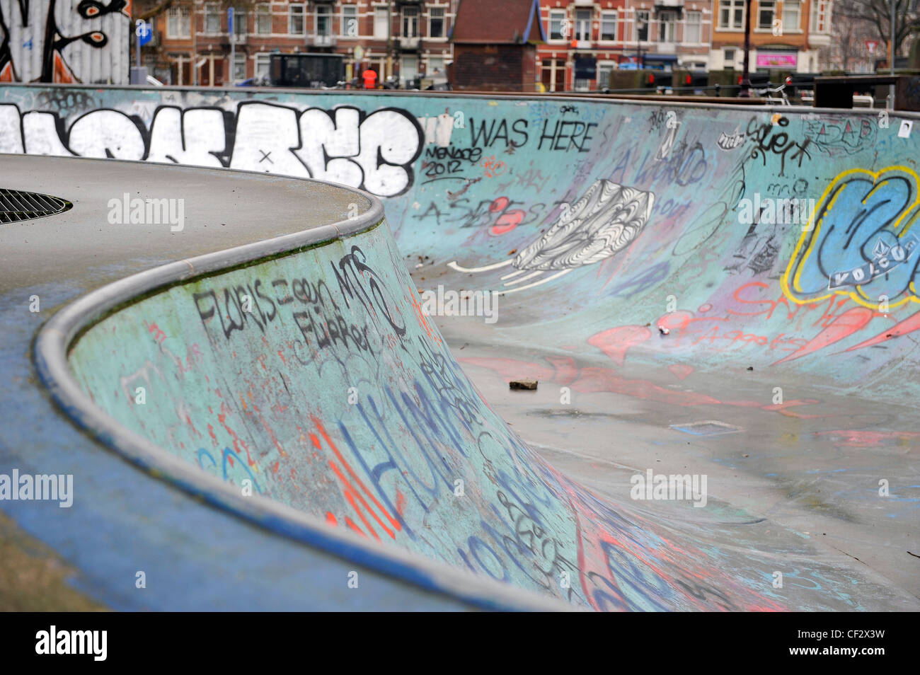 Graffiti on the walls of a bowl in a skatepark. Amsterdam, Netherlands. - Stock Image