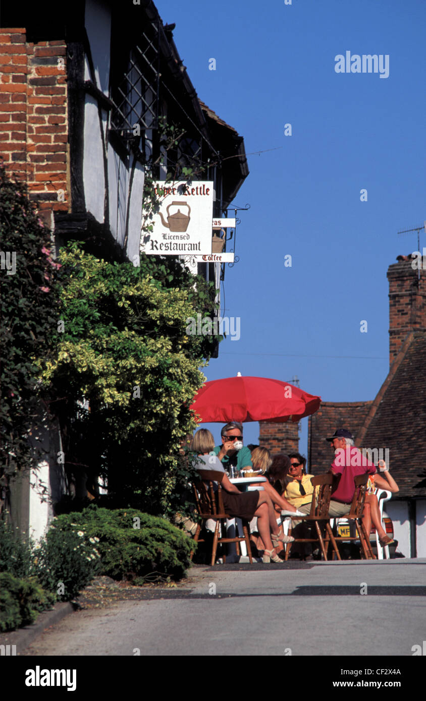 Enjoying tea and coffee on a sunny day in the Jacobean Village of Chilham, Kent, England Stock Photo