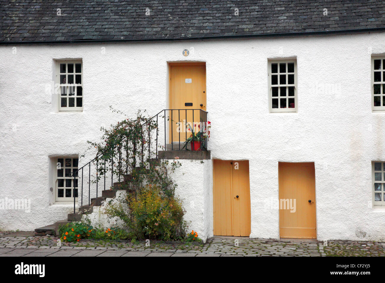 18th century merchants houses in Dunkeld, known as the Little houses, restored and let to local tenants to bring - Stock Image