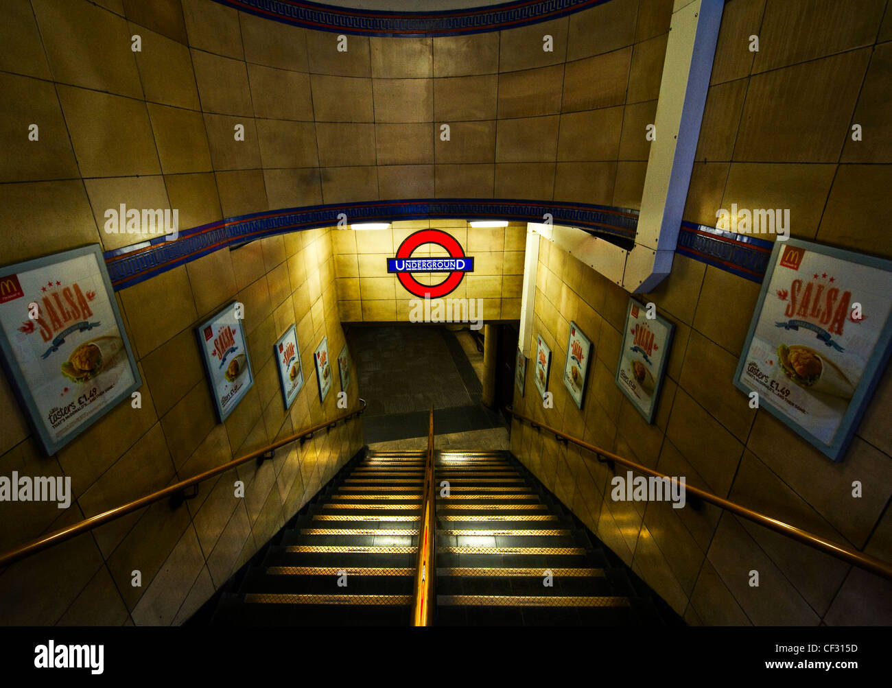 Steps leading down to a London Underground station. - Stock Image