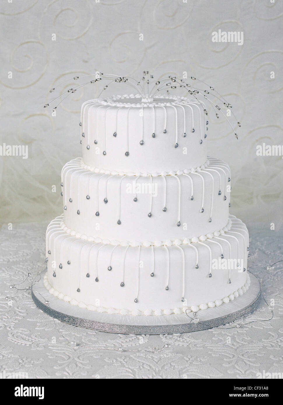 Fondant iced carrot cake with piping detail on white icing and spray ...