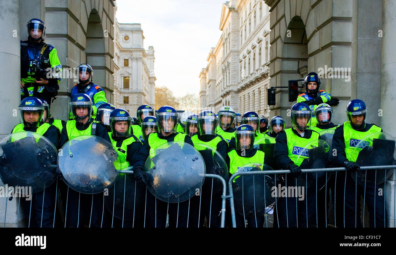 Metropolitan police in riot gear at a student demonstration. - Stock Image
