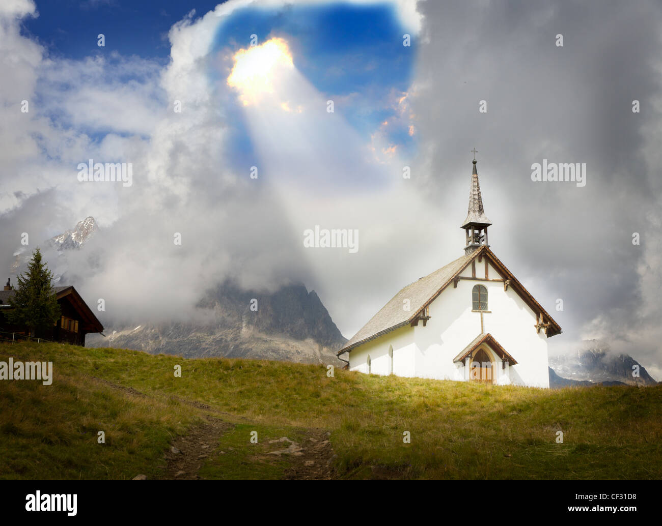 concept for christianity, god, belief, relief and trust: mountain chapel at Belalp near Aletsch glacier in a ray - Stock Image