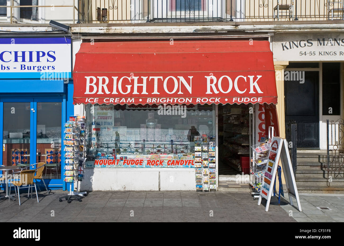 Brighton Rock shop selling postcards, ice cream, Brighton rock and fudge on the seafront in Brighton. - Stock Image