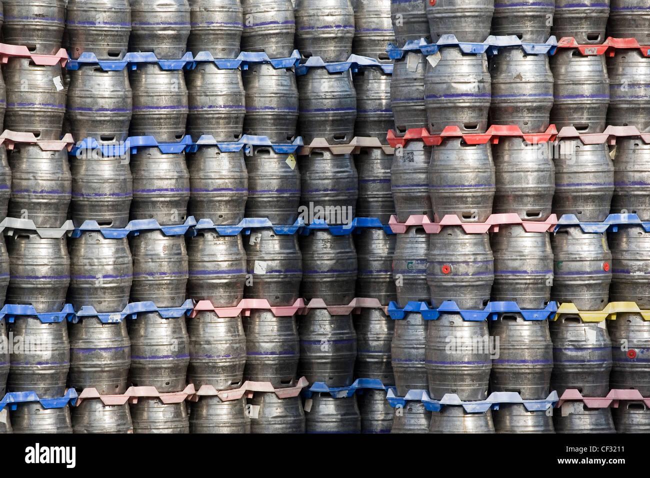 Beer kegs stacked at the Carlsberg Tetley brewery in Leeds. - Stock Image