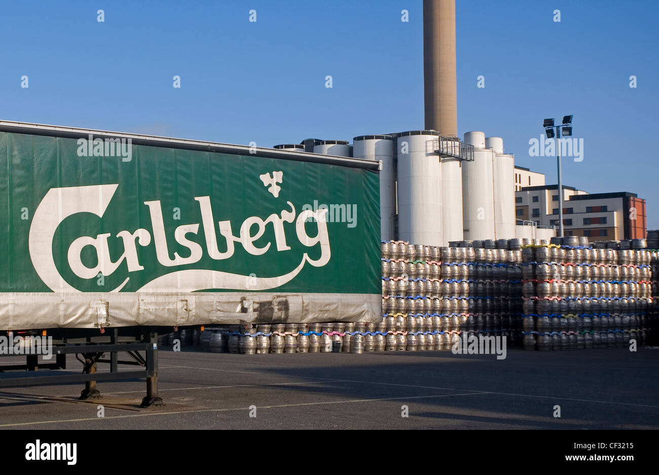 Beer kegs stacked outside the Carlsberg Tetley brewery ready to be loaded into a lorry container. - Stock Image