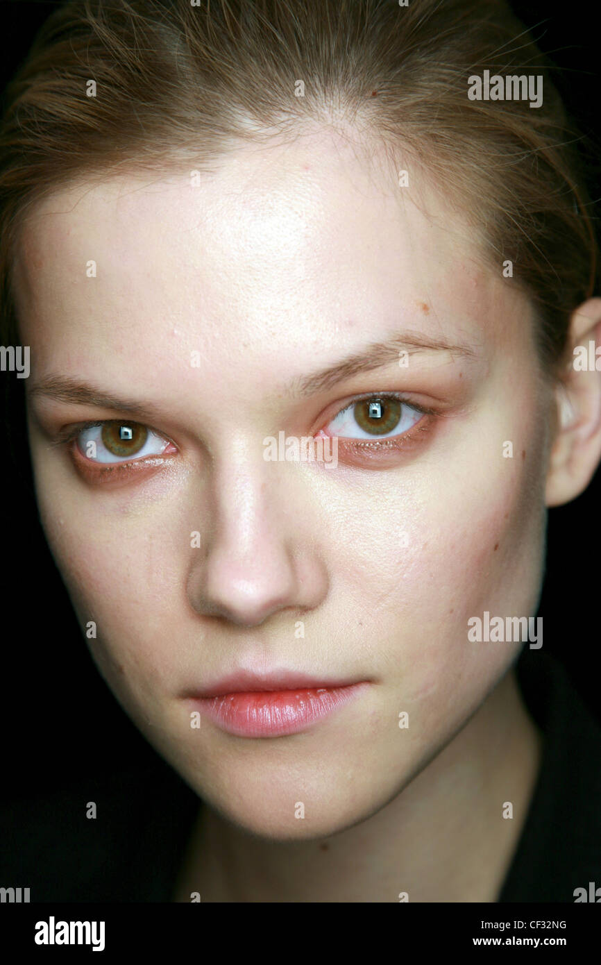 BCBG Backstage New York Ready to Wear Autumn Winter Head shot of female wearing smudged shimmering copper eyeshadow - Stock Image