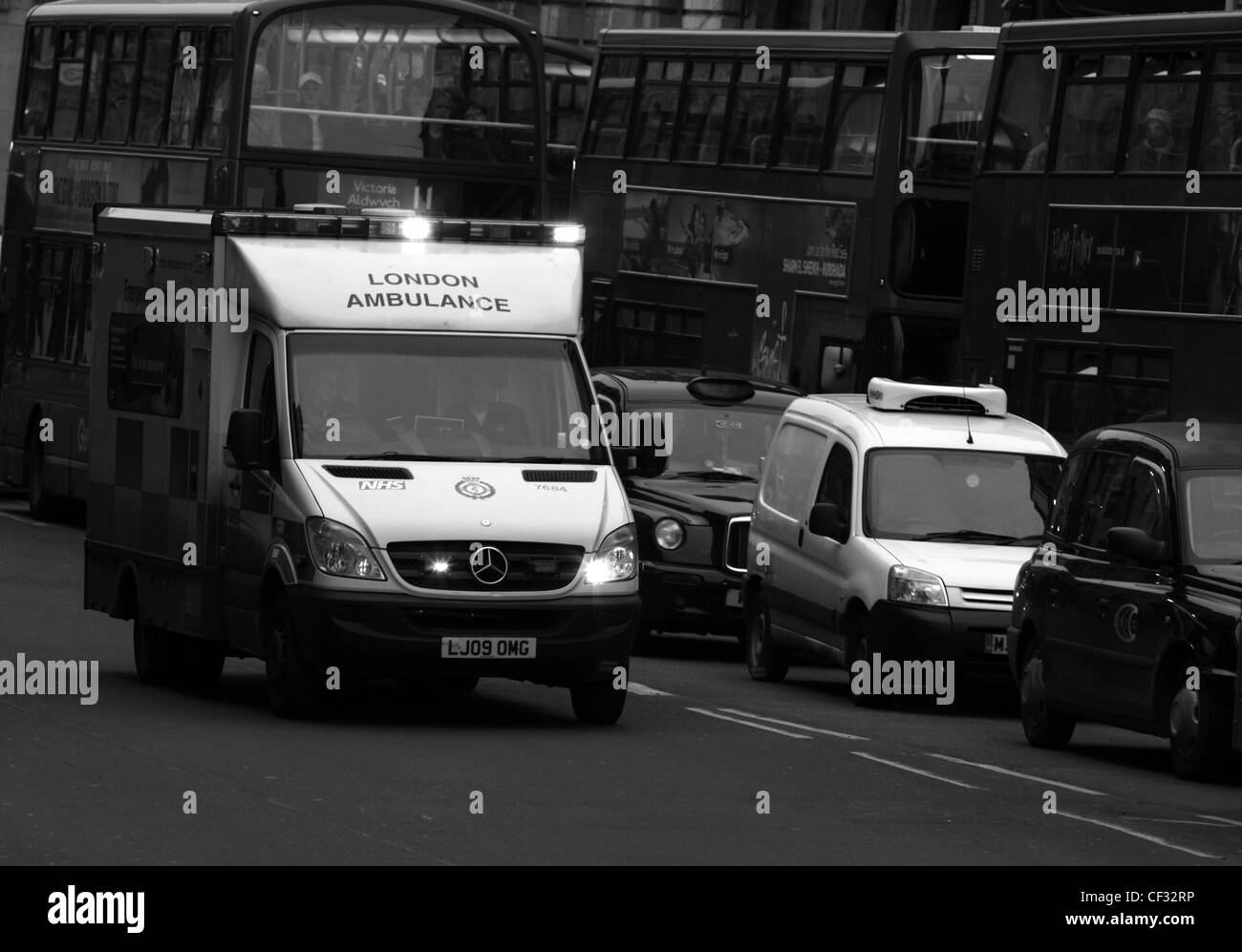 an ambulance traveling along a road in London - Stock Image