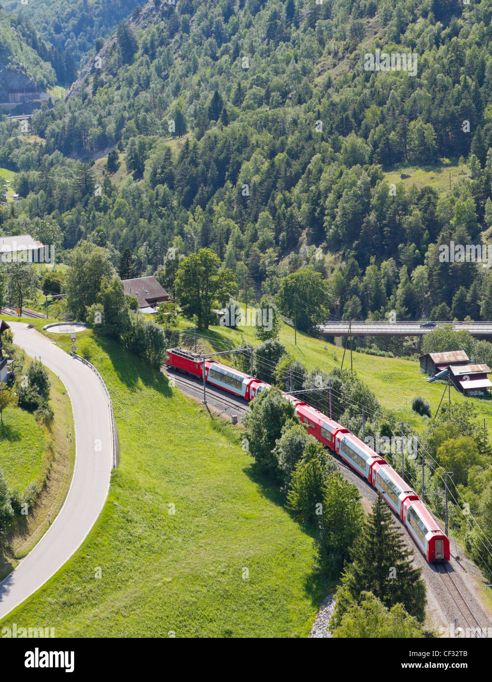 aerial view on glacier express panorama train crossing green rural valley, Vallais, Switzerland - Stock Image