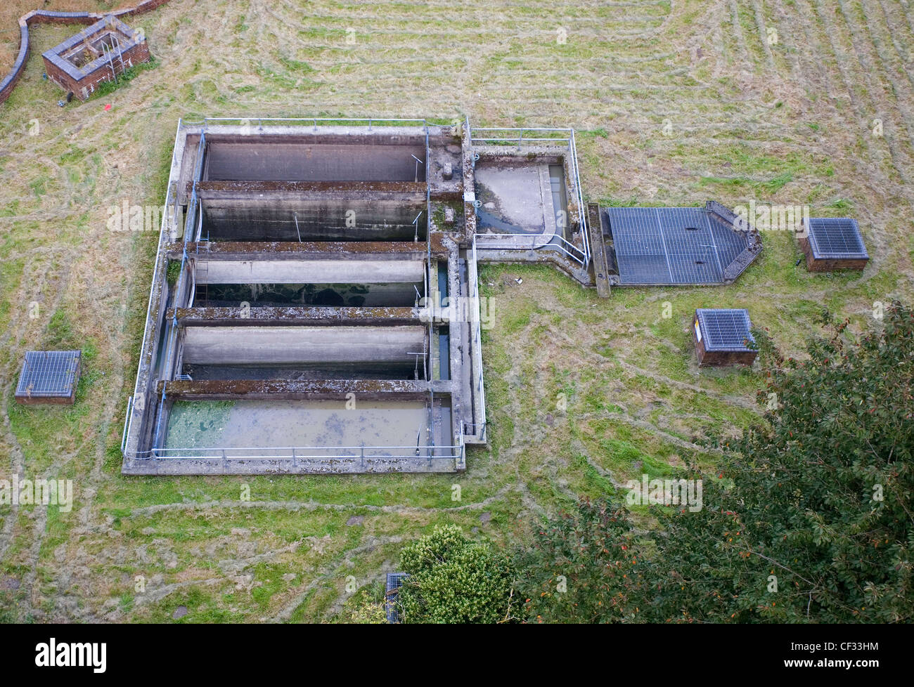 Settling tanks at a sewage treatment works, viewed from the Pontcysyllte Aqueduct. - Stock Image