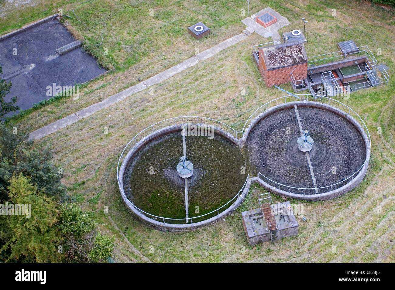 Rotary distributors and settling tanks at a sewage treatment works, viewed from the Pontcysyllte Aqueduct. - Stock Image