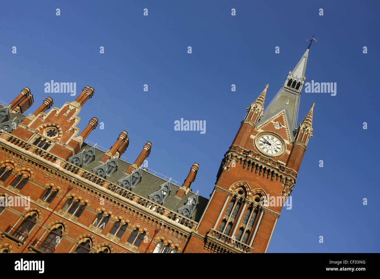 The Victorian architecture and clock tower of St Pancras Station in London. - Stock Image