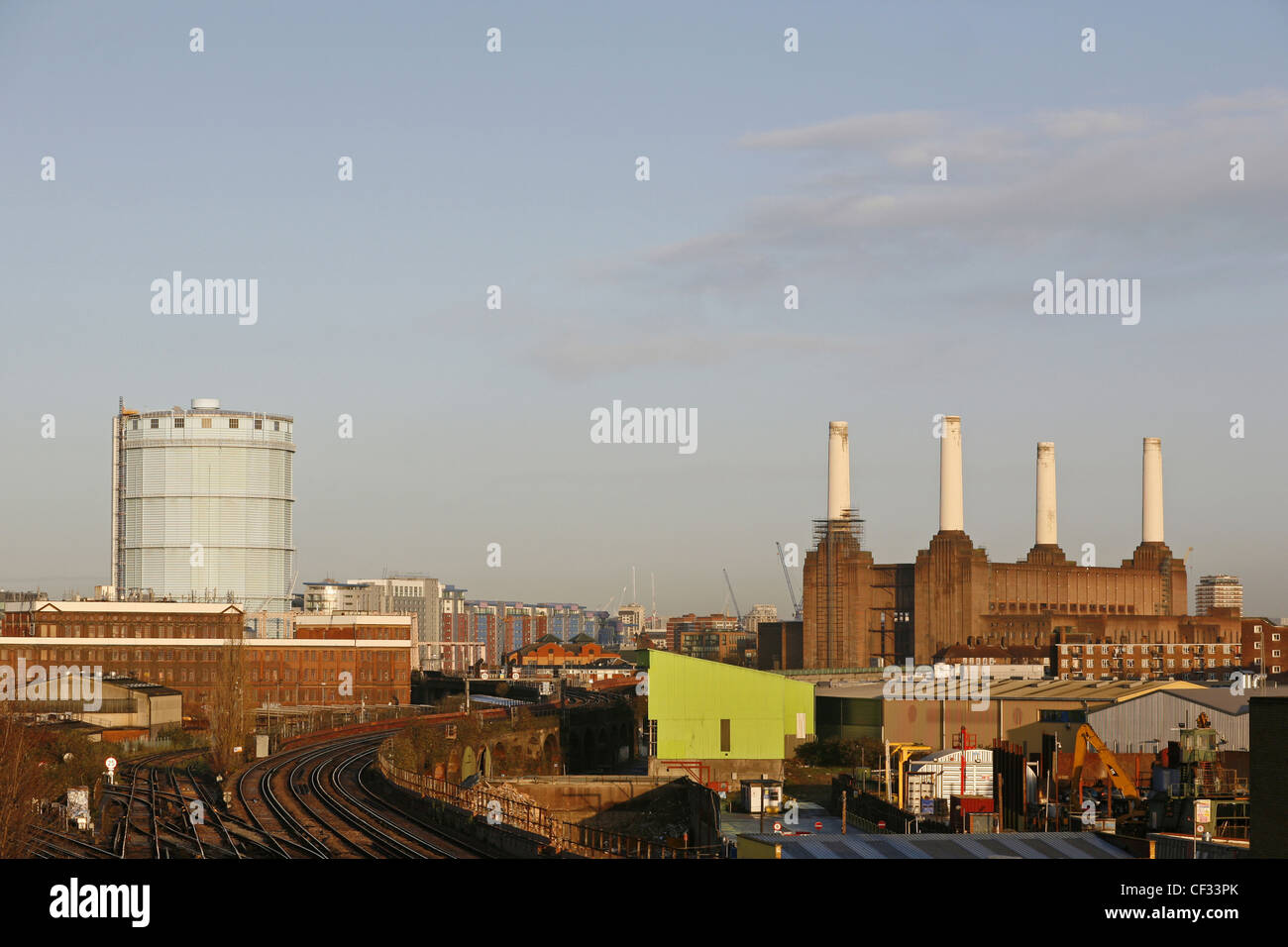 Railway tracks leading past the iconic London landmark, Battersea Power Station, which ceased producing electricity - Stock Image