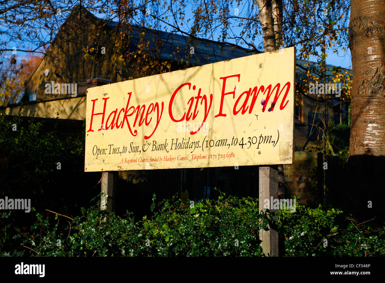 Hackney City Farm sign displaying opening times. Hackney City Farm is a community project offering city dwellers - Stock Image