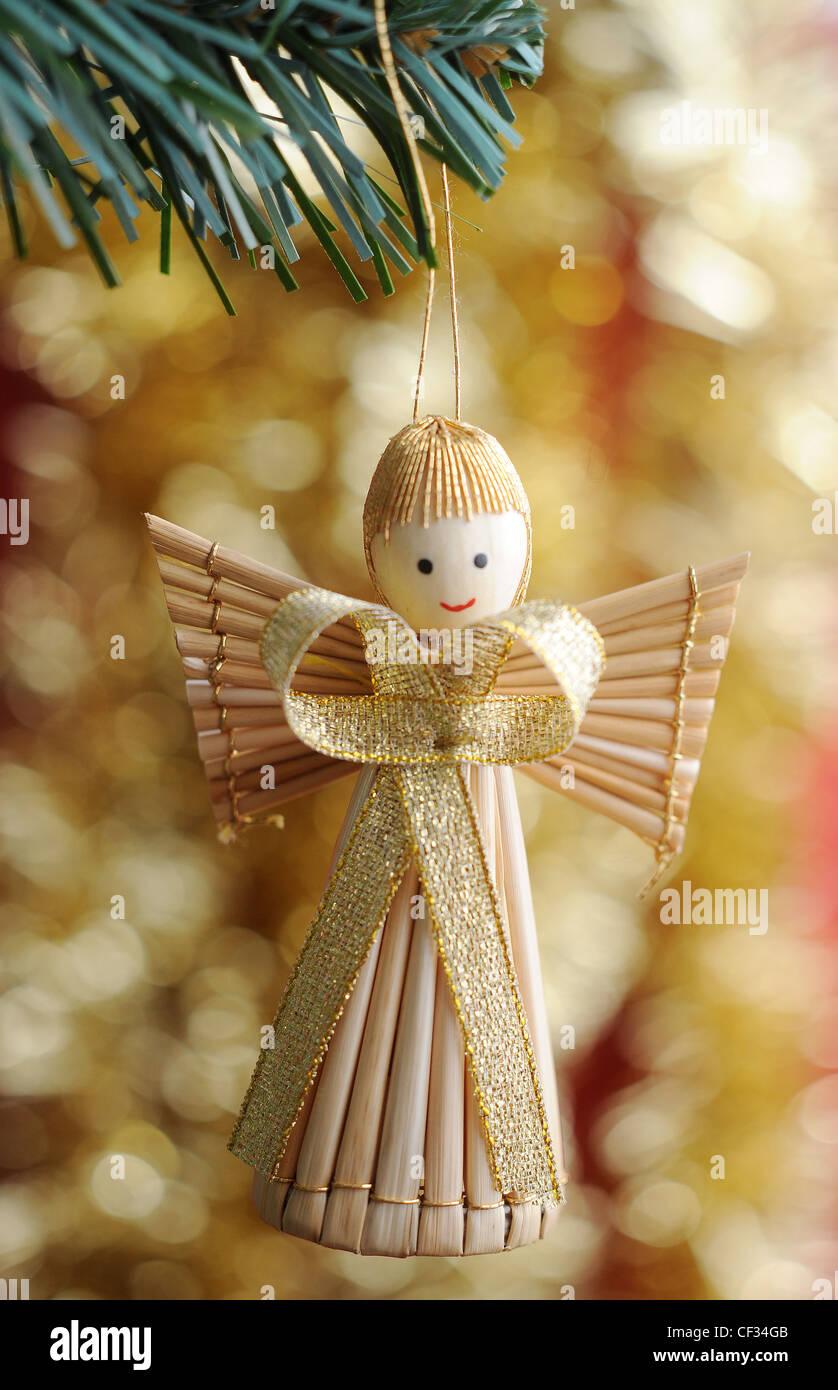 Angel Shaped Christmas Tree.A Straw Angel Shaped Tree Decoration Hanging Off A Christmas