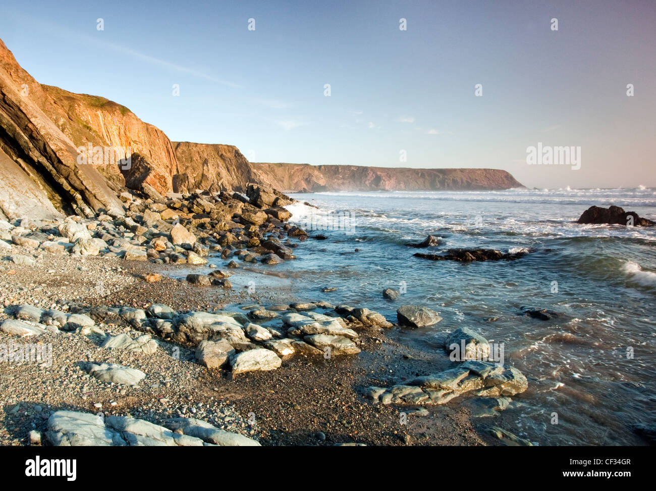 View of Irish sea with distant Hoopers Point, rock strewn coastline at Marloes Sands Pembrokeshire (National Trust) - Stock Image