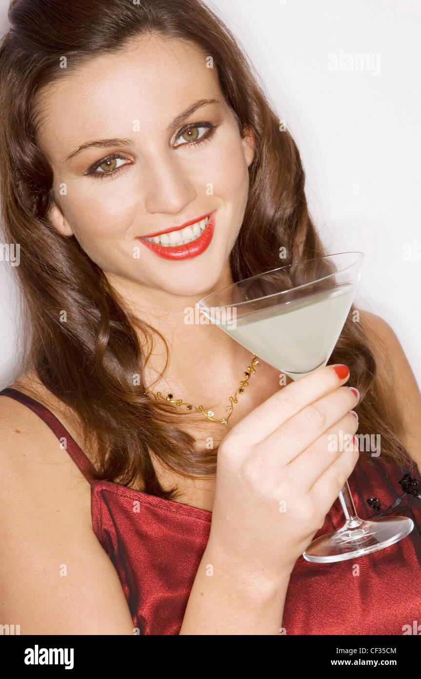 Female long wavy brunette hair wearing maroon red dress, gold Stock ...
