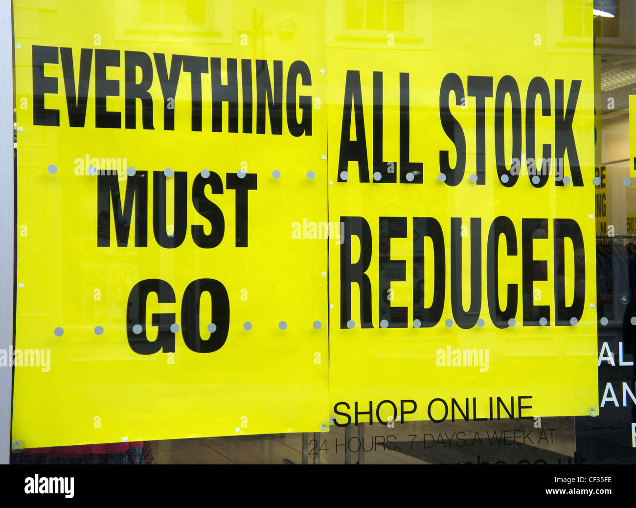 Sale signs in a shop window, UK - Stock Image