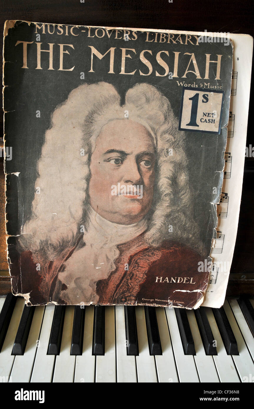 An old musical volume of Handel's 'The Messiah' sits on top of a  piano keyboard. - Stock Image