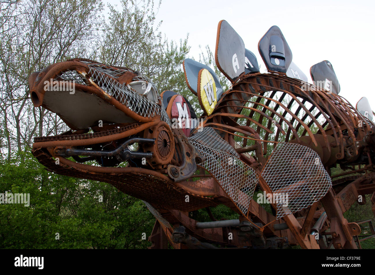 a life size sculpture representing a stegosaurus dinosaur created