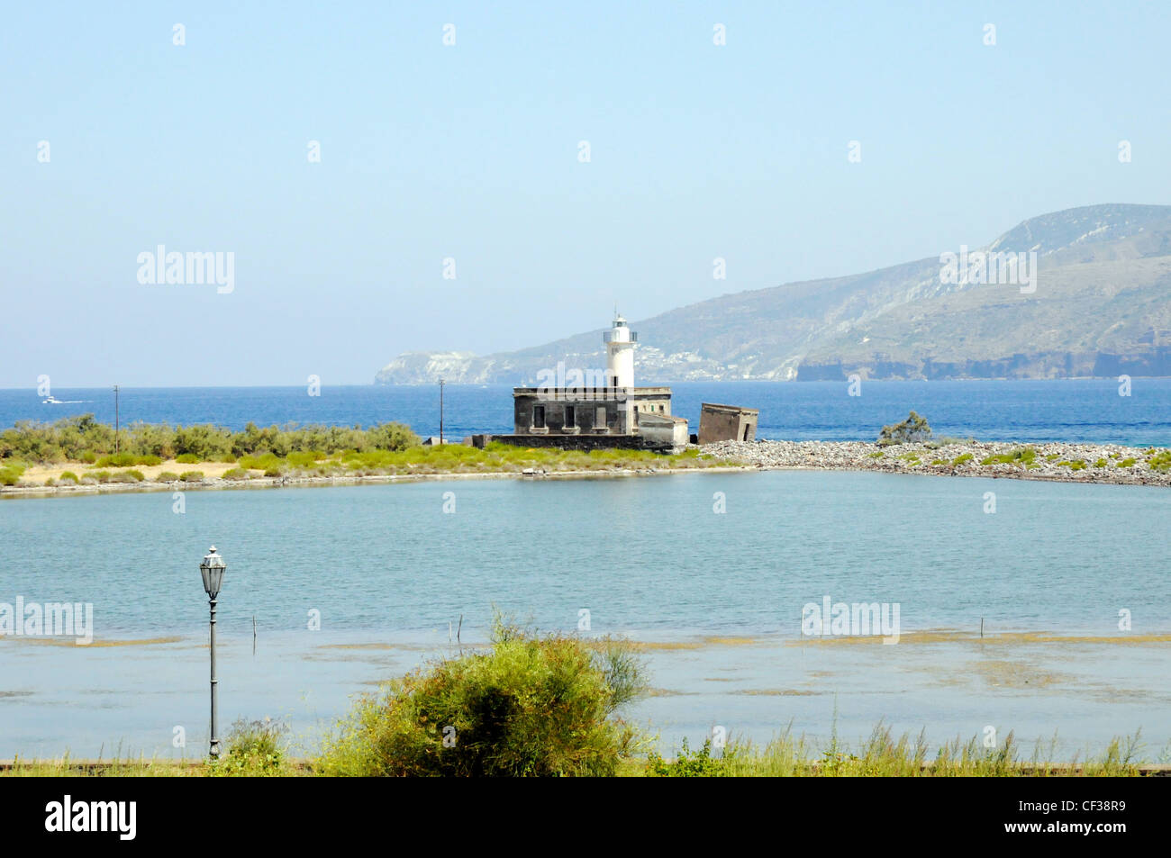 A lighthouse on the Laghetto di Lingua, or 'little salt lake', in the town of Lingua, on the Aeolian island - Stock Image