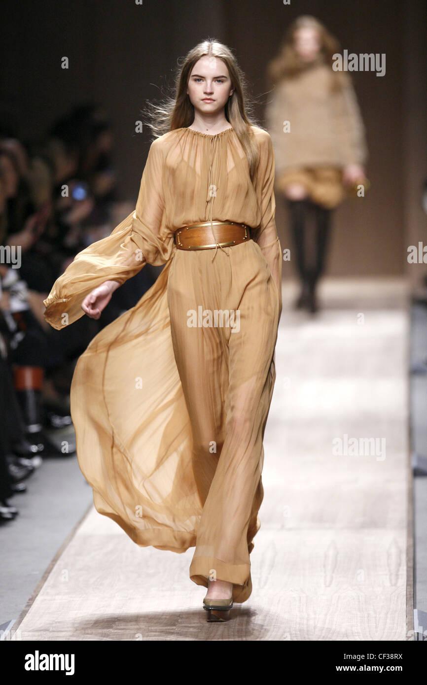 99babba53d518 Stella McCartney Paris Ready to Wear Autumn Winter Model wearing a light  brown flowing chiffon dress