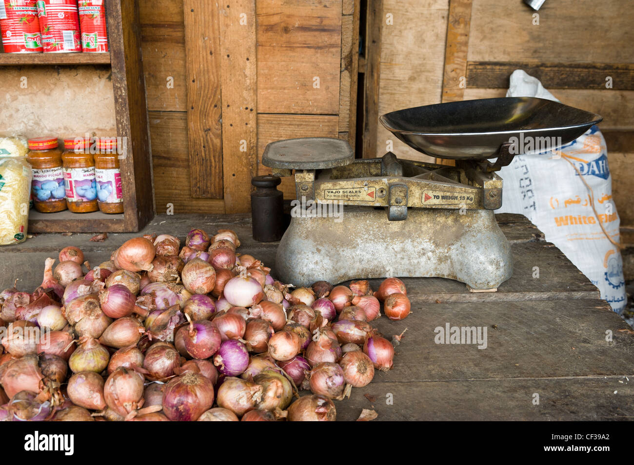 Onions and scale in Darajani market Stone Town Zanzibar Tanzania - Stock Image