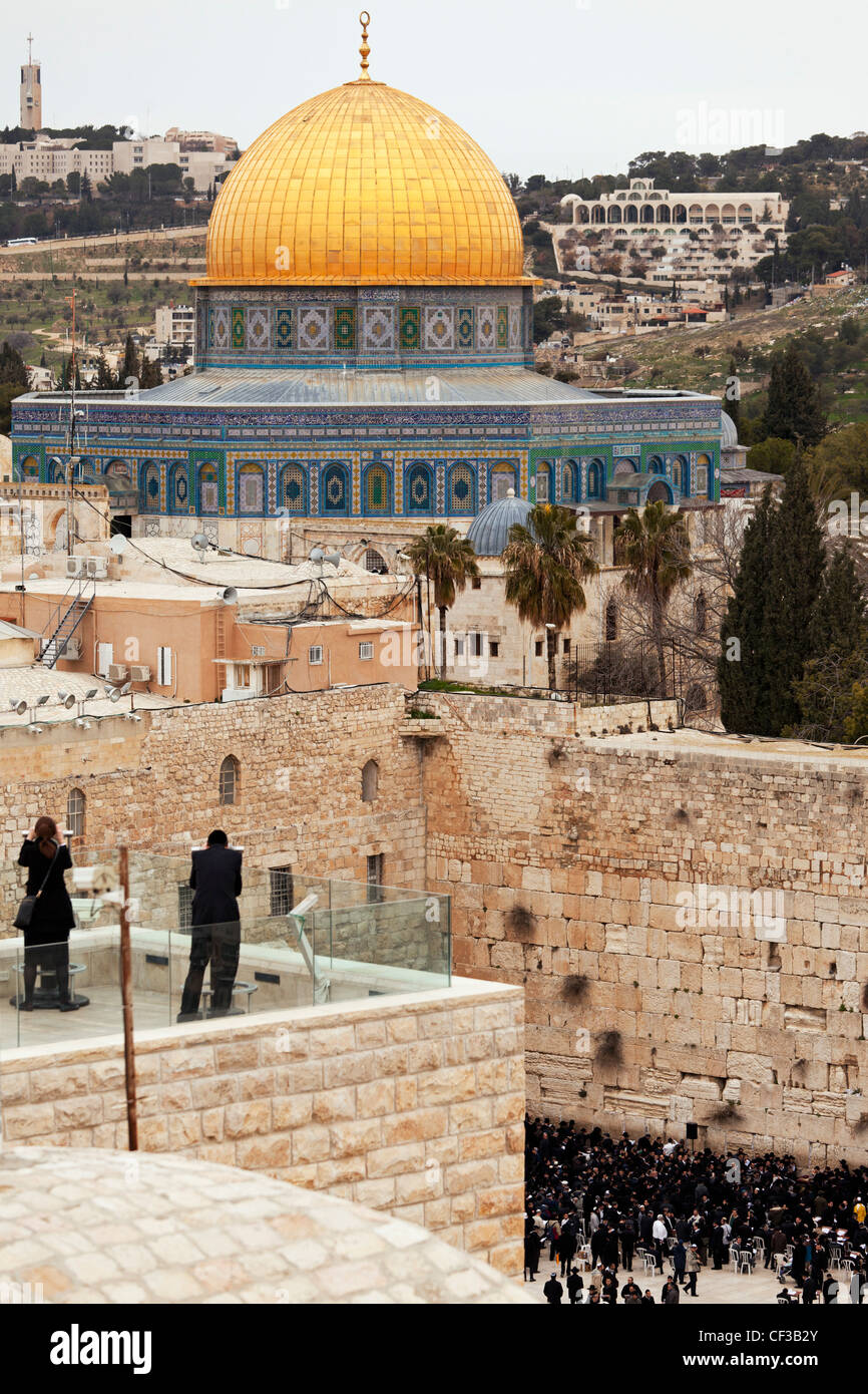 Israel,Jerusalem,couple at an overview of the Dome of the Rock and the Wailing Wall at dusk Stock Photo