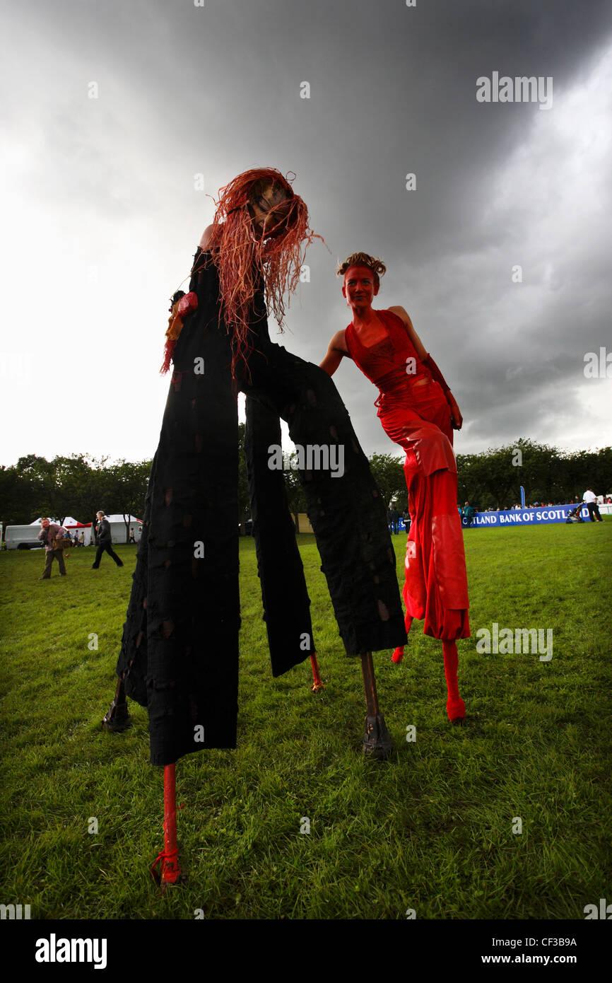 Performers on stilts at the Sunday Fringe  Festival in Edinburgh. - Stock Image
