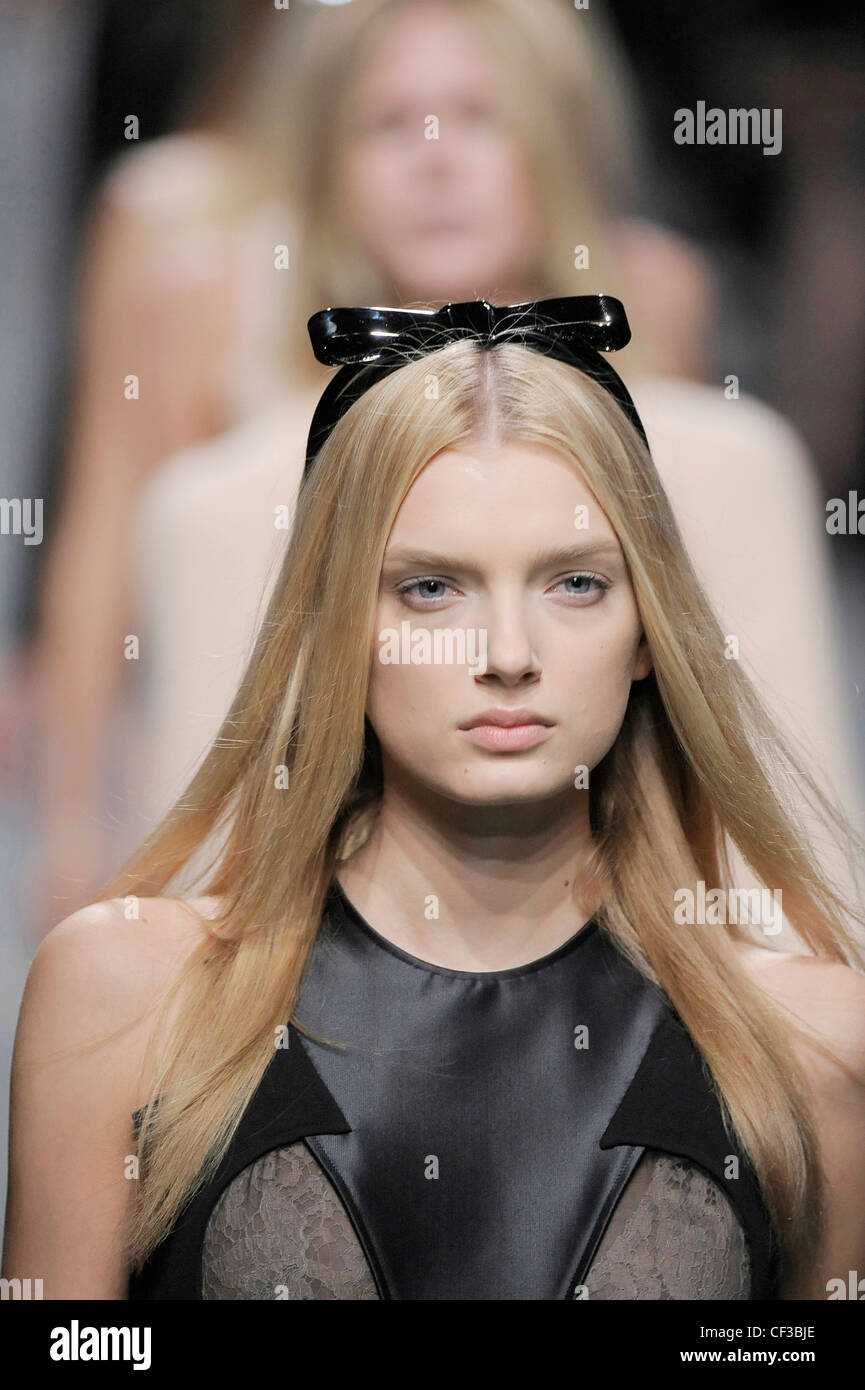 a16fd2f836e2 Givenchy Paris Ready to Wear Spring Summer Model wearing grey satin  sleeveless top grey lace panels
