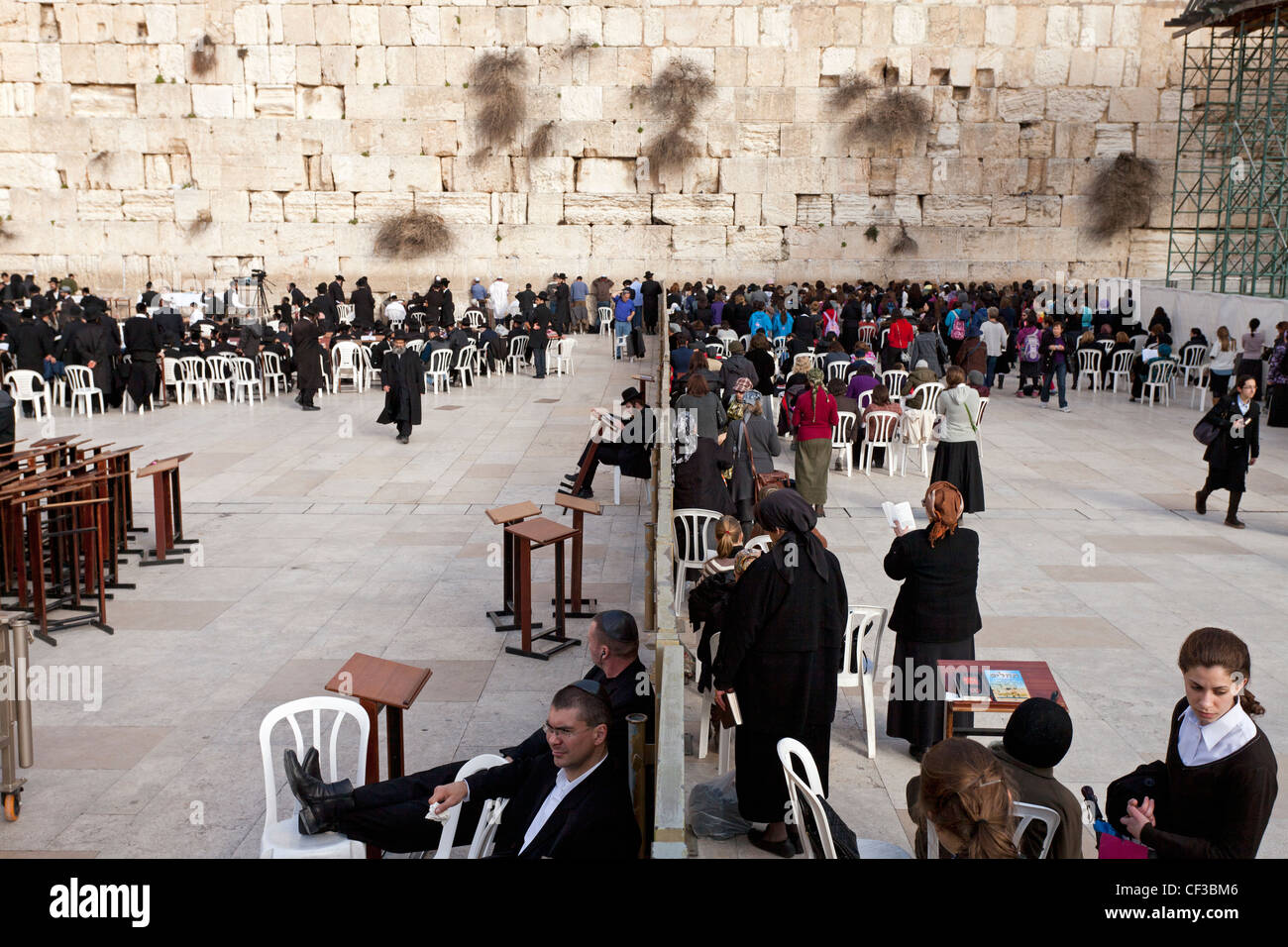 Israel,Jerusalem, The Wailing Wall, showing the wall that segregates men from women praying - Stock Image