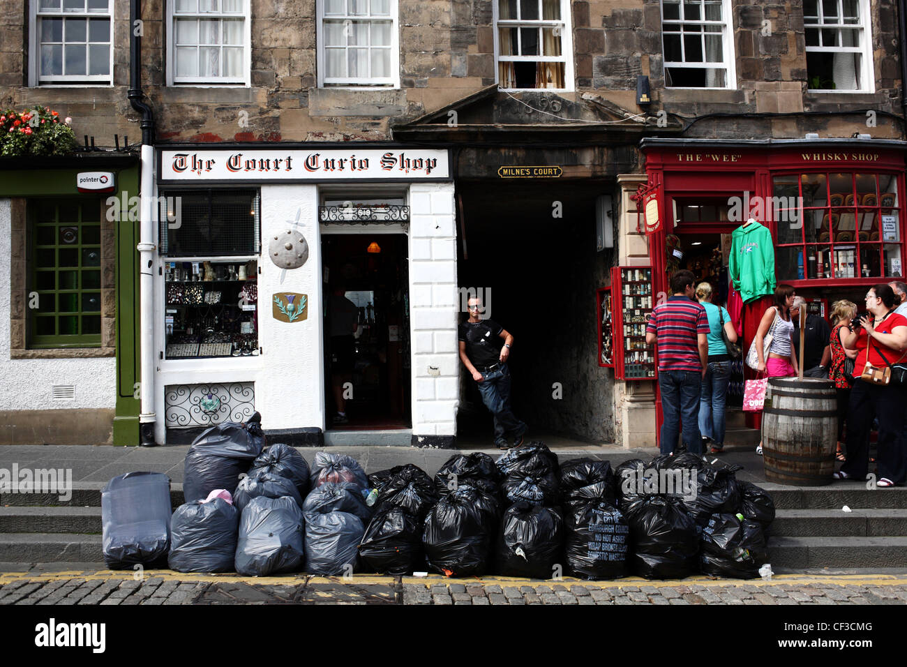 Rubbish bags mounting up in the Royal Mile due to a strike. - Stock Image